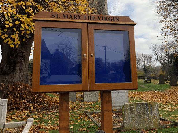 oak noticeboard on oak posts, church